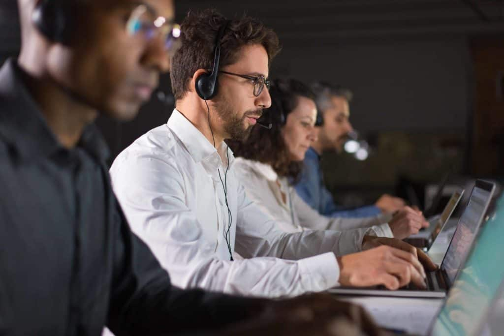 confident-call-center-operator-talking-with-client (1)